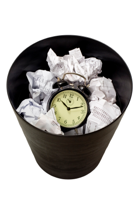 Clock in waste paper basket