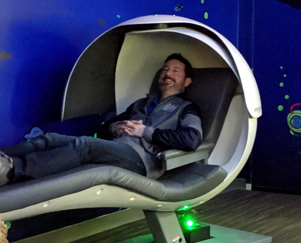Adam in the Zappos HQ Nap Pod